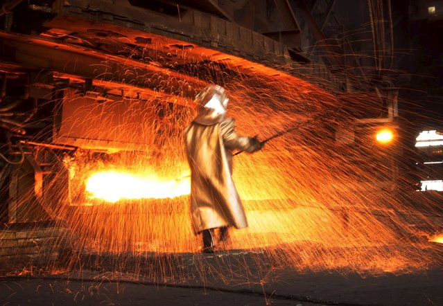 A worker processes nickel at a nickel smelter near Sorowako, Indonesia's Sulawesi island, in this January 8, 2014 file photo. (Photo by Yusuf Ahmad/Reuters)
