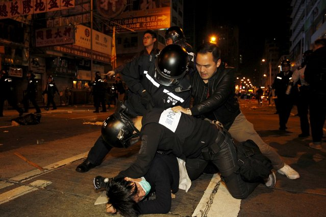 A protester (bottom) is arrested by riot police during a clash at Hong Kong's Mongkok shopping district, China early February 9, 2016. Police say three people have been arrested after a clash over illegal hawkers, leading to a standoff involving riot police, government radio reported. (Photo by Liau Chung-ren/Reuters)