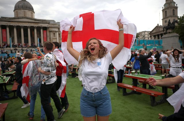 England fans celebrate the first goal while watching the  UEFA EURO 2020 final football match between Italy and England at the Wembley Stadium at Trafalgar Square in London, Britain on July 11, 2021. (Photo by Henry Nicholls/Reuters)