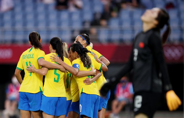 Andressinha of Brazil celebrates scoring their fourth goal with teammates as Peng Shimeng of China reactsl during the Tokyo 2020 Olympic Football Tournament match between China and Brazil at Miyagi Stadium on July 21, 2021 in Rifu, Japan. (Photo by Molly Darlington/Reuters)