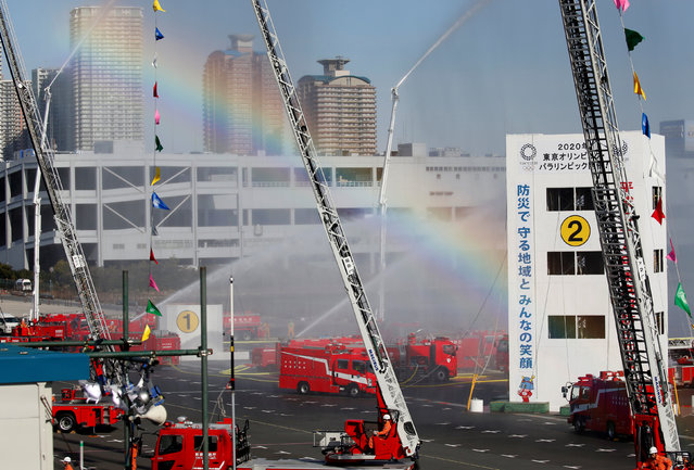 A rainbow is seen during a New Year demonstration by the fire brigade in Tokyo, Japan, January 6, 2017. (Photo by Toru Hanai/Reuters)