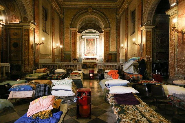 Beds are seen inside the San Callisto church as which serves as a dormitory for the homeless while a cold snap persists in Rome, January 13, 2017. (Photo by Alessandro Bianchi/Reuters)