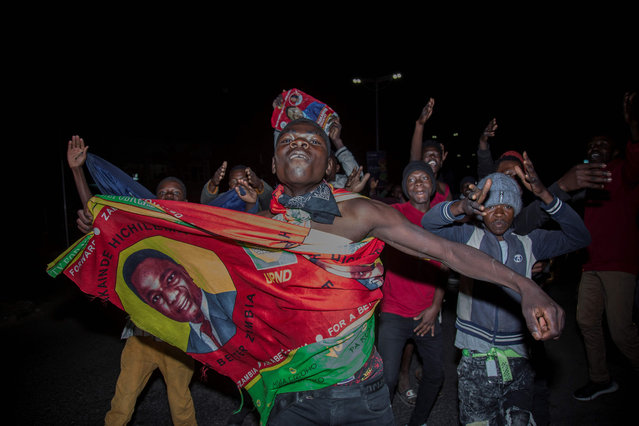 Supporters of Zambian presidential candidate for the opposition party United Party for National Development (UPND) Hakainde Hichilema celebrate his election as Zambian President in Lusaka, on August 16, 2021. Zambia's opposition leader Hakainde Hichilema was on August 16, 2021 declared winner of the hotly contested presidential election after capturing more than 2.8 million votes. (Photo by Salim Dawood/AFP Photo)