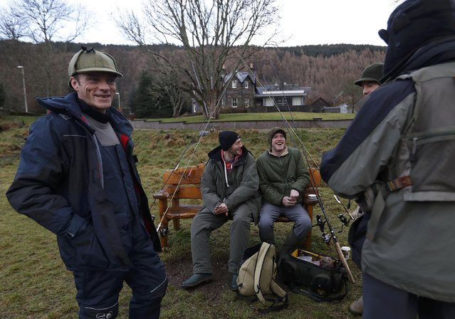 Anglers share a joke as they take a break on the river bank  on the opening day of the salmon fishing season on the River Tay at Kenmore in Scotland, Britain January 16, 2017. (Photo by Russell Cheyne/Reuters)