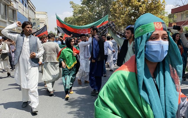 Afghans hold national flags as they celebrate the Independence Day in Kabul, Afghanistan, 19 August 2021. Afghanistan's celebrates the 102nd anniversary of its independence from British rule on 18 August. (Photo by EPA/EFE/Stringer)