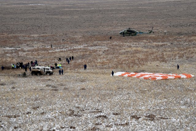 Members of a search and rescue team work at the site of landing of the Soyuz TMA-18M spacecraft, which carried International Space Station (ISS) crew members U.S. astronaut Scott Kelly, Russian cosmonauts Sergei Volkov and Mikhail Korniyenko near the town of Dzhezkazgan (Zhezkazgan), Kazakhstan, March 2, 2016. (Photo by Kirill Kudryavtsev/Reuters)