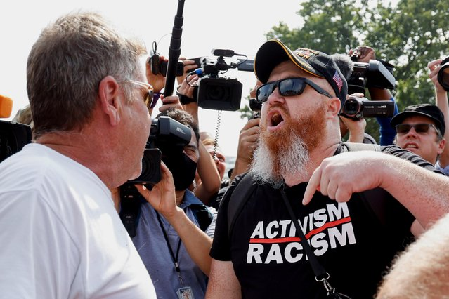 Counter-protester Russell Tee confronts a demonstrator during a rally in support of defendants being prosecuted in the January 6 attack on the U.S. Capitol, in Washington, D.C., U.S., September 18, 2021. (Photo by Jonathan Ernst/Reuters)