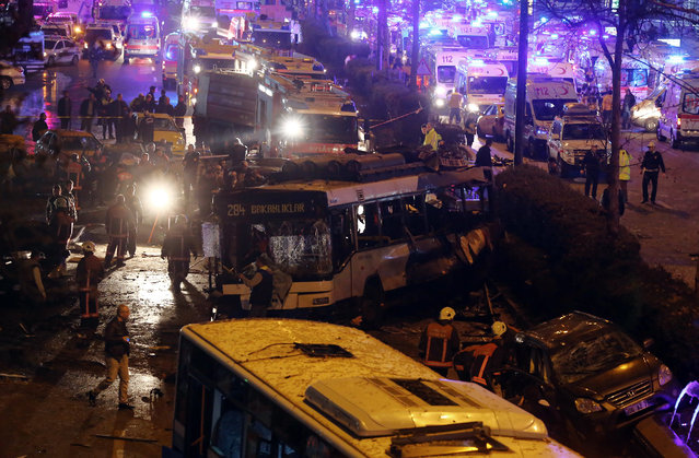 Emergency services work at the explosion site in the busy center of Turkish capital, Ankara, Turkey, Sunday, March 13, 2016. (Photo by AP Photo)