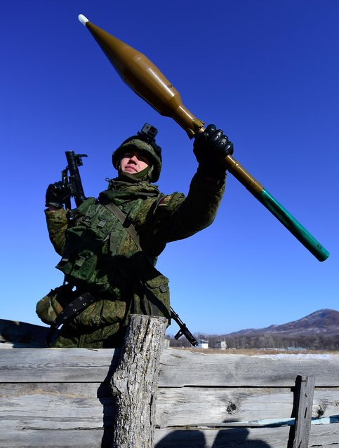 A marine with an RPG-7, a portable rocket- propelled grenade launcher, during military exercises conducted by the Russian Pacific Fleet' s naval infantry unit at the Bamburovo firing range on February 2, 2017. (Photo by Yuri Smityuk/TASS)