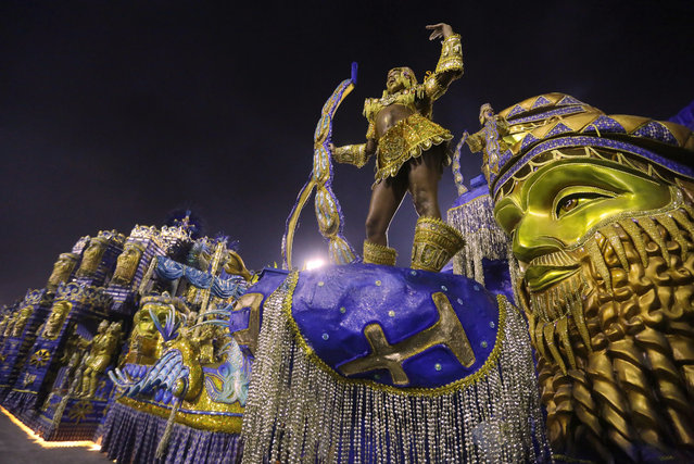 Performers from the Beija Flor samba school parade during carnival celebrations at the Sambadrome in Rio de Janeiro, Brazil, Monday, March 3, 2014. (Photo by Nelson Antoine/AP Photo)