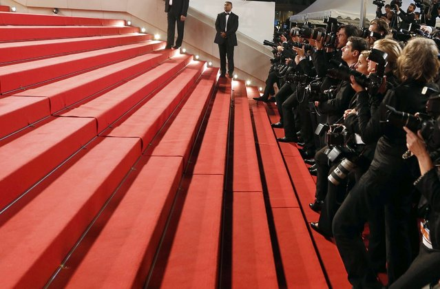 """Photographers work on the red carpet after the screening of the film """"Mad Max: Fury Road"""" out of competition at the 68th Cannes Film Festival in Cannes, southern France, May 14, 2015. (Photo by Regis Duvignau/Reuters)"""