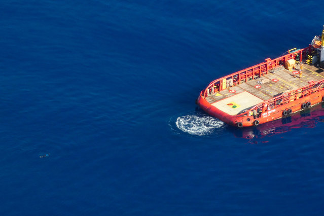 Aerial view shows a migrant swimming towards Gibraltar-registered Vos Triton commercial offshore supply ship, in Search and Rescue (SAR) zone off Libya's coast May 11, 2019, as seen from Germany's Sea-Watch humanitarian organisation's Moonbird aircraft. (Photo by Sea-Watch.org/Handout via Reuters)