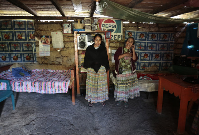 Alicia Chiquin, 43, and her daughter Fidelina Ja, 18, pose for a photograph at their home in Pambach, Guatemala February 20, 2014. Alicia has no education and has always worked the land. Her daughter Fidelina also has no education and when she grows up she says she will continue to work at home and on the land. (Photo by Jorge Dan Lopez/Reuters)