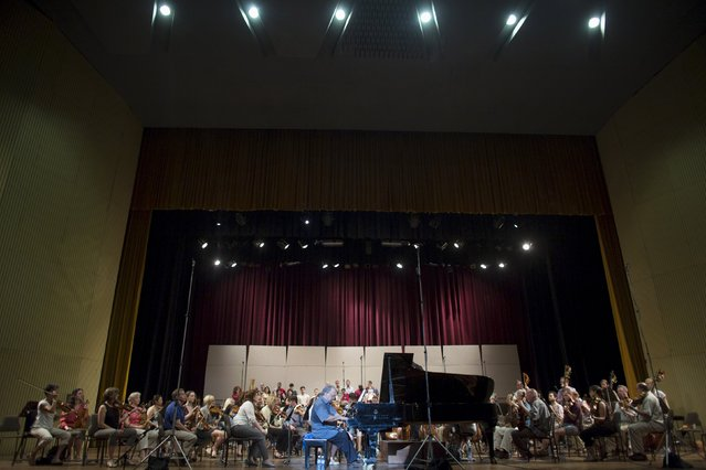 Cuban pianist Frank Fernandez, (C), performs with the Minnesota Orchestra during a rehearsal in Havana May 14, 2015. (Photo by Alexandre Meneghini/Reuters)