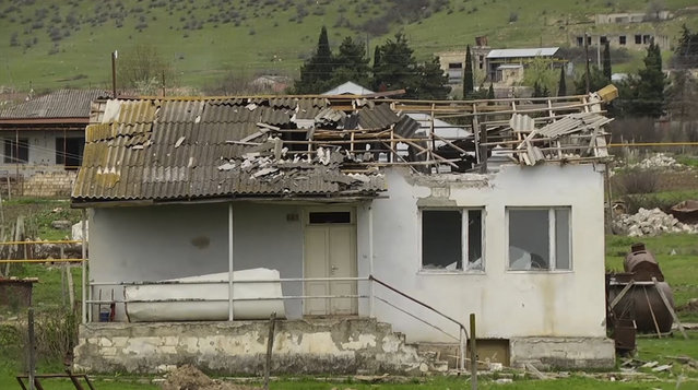 In this grab taken from Associated Press Television footage made available on Monday, April  4, 2016, a house ruined by shelling on Sunday, April 3, 2016, in the village of Mardakert, in the separatist region of Nagorno-Karabakh. (Photo by Associated Press Television via AP Photo)