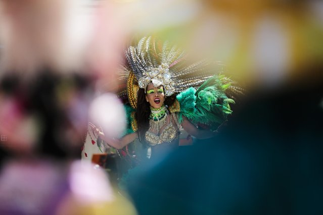 A samba dancer performs at the annual Carnival of Cultures parade in Berlin, Germany, Sunday, May 24, 2015. (Photo by Markus Schreiber/AP Photo)