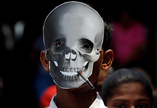 A child wearing a skull mask attends an anti-tobacco awareness rally during the World No Tobacco Day in Kolkata, India, May 31, 2019. (Photo by Rupak De Chowdhuri/Reuters)