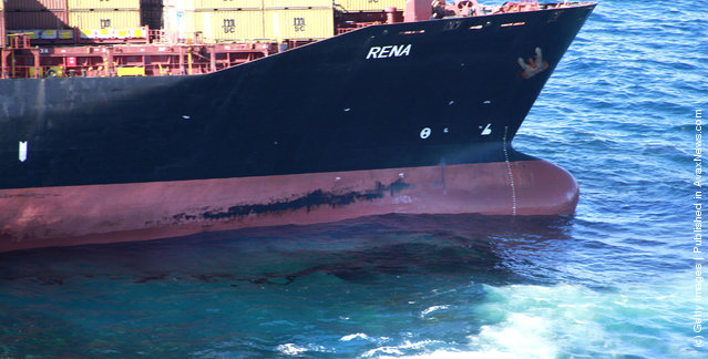 Fly-over shots of stranded cargo vessel Rena grounded on the Astrolabe Reef