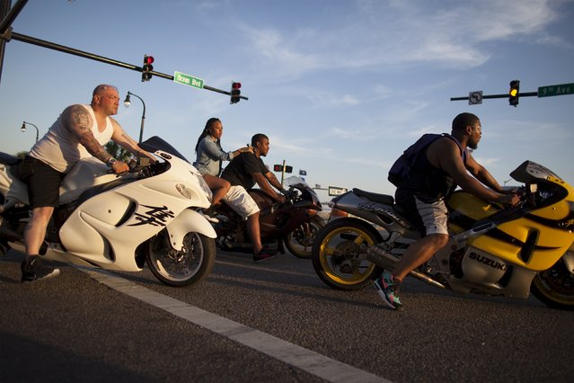 Bikers cruise to 9th Avenue South near Ocean Boulevard during the 2015 Atlantic Beach Memorial Day BikeFest in Myrtle Beach, South Carolina May 24, 2015. (Photo by Randall Hill/Reuters)