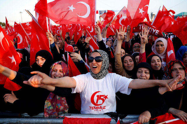 Supporters of Turkish President Tayyip Erdogan wave national flags during a ceremony marking the third anniversary of the attempted coup at Ataturk Airport in Istanbul, Turkey, July 15, 2019. (Photo by Murad Sezer/Reuters)