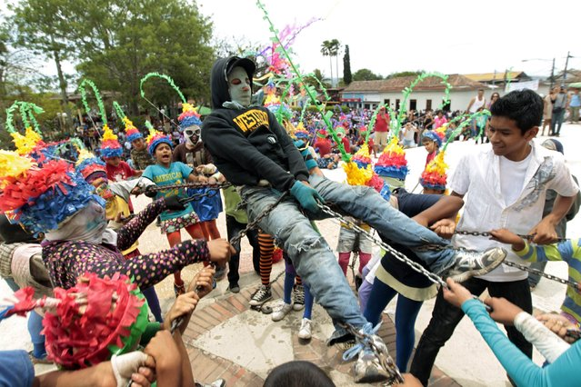 """Another Judas is """"abused"""" by the crowd. (Photo by Oswaldo Rivas/Reuters)"""