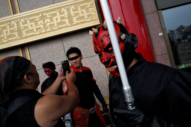 A man dressed as Darth Maul (R) from Star Wars reacts during Star Wars Day in Taipei, Taiwan, May 4, 2016. (Photo by Tyrone Siu/Reuters)