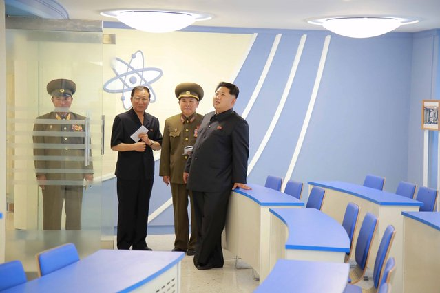 North Korean leader Kim Jong Un (R) stands during a visit to a newly-built building of the Automation Institute of the Kim Chaek University of Technology in Pyongyang, in this undated picture released by North Korea's Korean Central News Agency (KCNA) on July 3, 2015. (Photo by Reuters/KCNA)