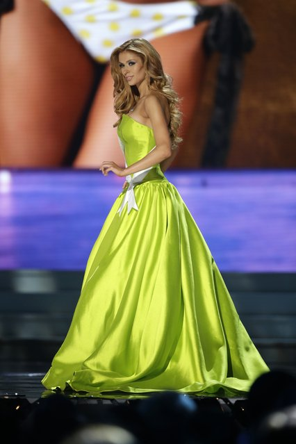 Miss Michigan, Rashontae Wawrzyniak, competes in the evening gown competition during the preliminary round of the 2015 Miss USA Pageant in Baton Rouge, La., Wednesday, July 8, 2015. (Photo by Gerald Herbert/AP Photo)