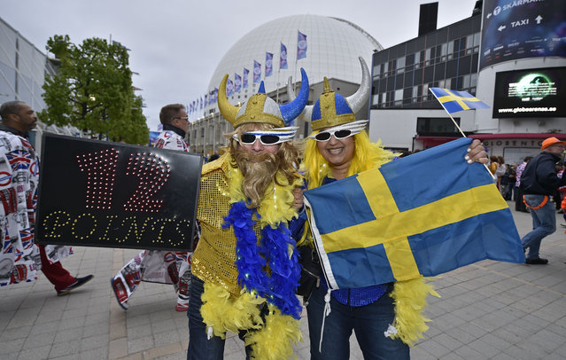 Eurovision fans from Sweden pose in front of the Globen Arena prior the first the Eurovision Song Contest final in Stockholm, Sweden, Saturday, May 14, 2016. (Photo by Martin Meissner/AP Photo)