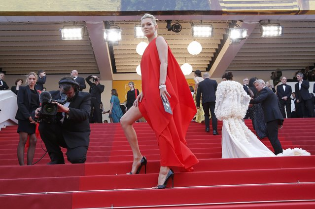 """Model Kate Moss poses on the red carpet as she arrives for the screening of film """"Loving"""" in competition at the 69th Cannes Film Festival in Cannes, France, May 16, 2016. (Photo by Jean-Paul Pelissier/Reuters)"""