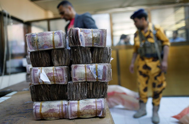 Bundles of Yemeni currency are pictured at a post office before being handed to public sector employees as salaries in Sanaa, Yemen January 25, 2017. (Photo by Khaled Abdullah/Reuters)