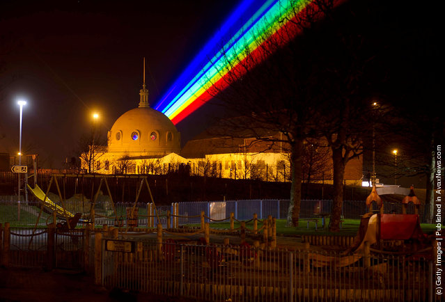 International artist Yvette Mattern shows her stunning laser rainbow projection, Global Rainbow