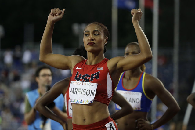 USA's Queen Harrison celebrates after winning the women's 100 meter hurdles at the Pan Am Games in Toronto, Tuesday, July 21, 2015. (Photo by Mark Humphrey/AP Photo)