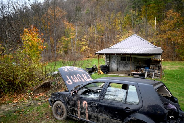 """""""TRUMP 2020"""" is painted on an VW sedan abandoned on the side of the road on election day for local and states in Northumberland County, Pennsylvania U.S. on November 5, 2019. (Photo by Mark Makela/Reuters)"""