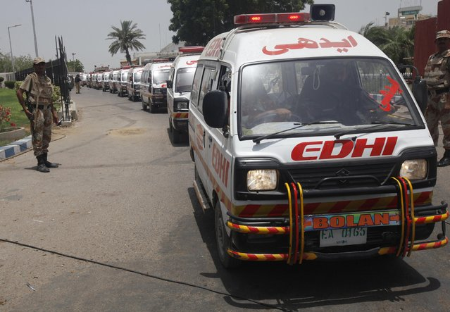 Ambulances carrying bodies of those killed in an attack leave Jinnah International Airport in Karachi June 9, 2014. REUTERS/Athar Hussain