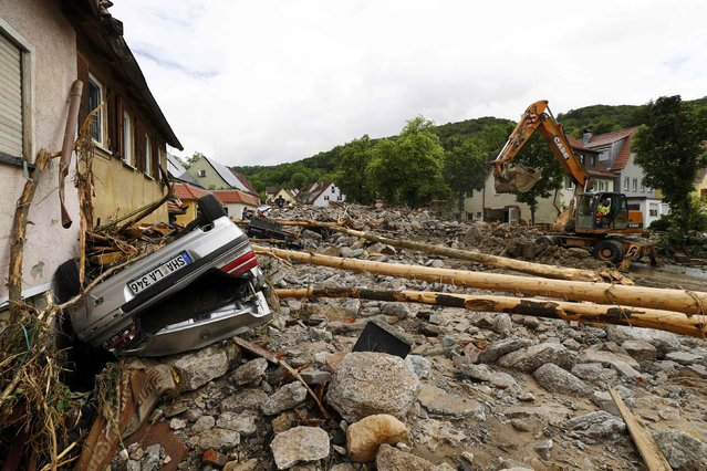 A damaged car is pictured after floods in the town of Braunsbach, Germany, May 30, 2016. (Photo by Kai Pfaffenbach/Reuters)