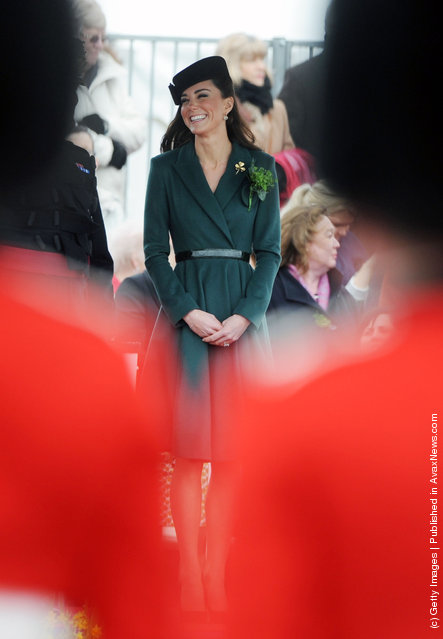 Catherine, Duchess of Cambridge presents shamrocks to members of the 1st Battalion Irish Guards at the St Patrick's Day Parade at Mons Barracks on Saturday March 17, 2012 in Aldershot, England