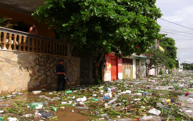 Debris litters a street flooded by the rains of Tropical Storm Beatriz in Juchitan, in Oaxaca state, Mexico, June 2, 2017. (Photo by Rusvel Rasgado/Reuters)