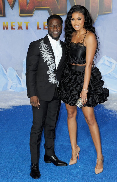"""Kevin Hart and wife Eniko Parrish  arrive at the Premiere of Sony Pictures' """"Jumanji: The Next Level"""" held at TCL Chinese Theatre on December 9, 2019 in Hollywood, California. (Photo by Albert L. Ortega/Getty Images)"""