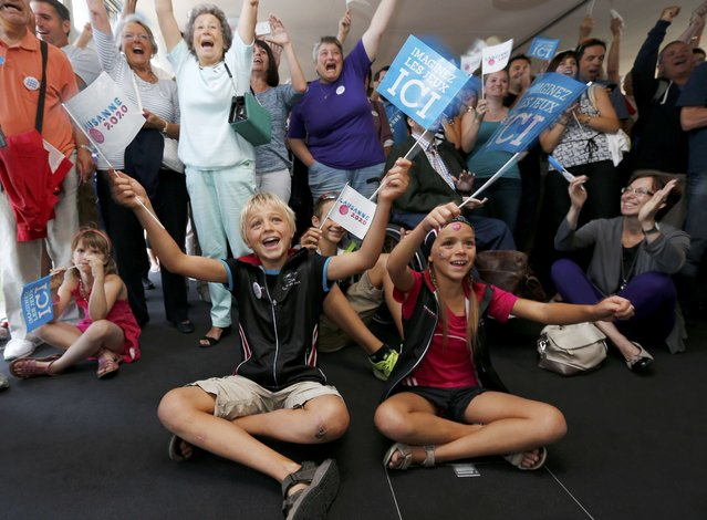 Supporters celebrate after the International Olympic Committee (IOC) 128th Session vote on the 2020 Youth Winter Olympic games in favour of Lausanne during a live broadcast ceremony in Lausanne, Switzerland July 31, 2015. Lausanne was chosen against the Romanian city of Brasov. (Photo by Denis Balibouse/Reuters)