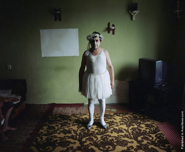 Retired circus artiste Jozef Maksymiuk (59) at home dressed in one of his old costumes