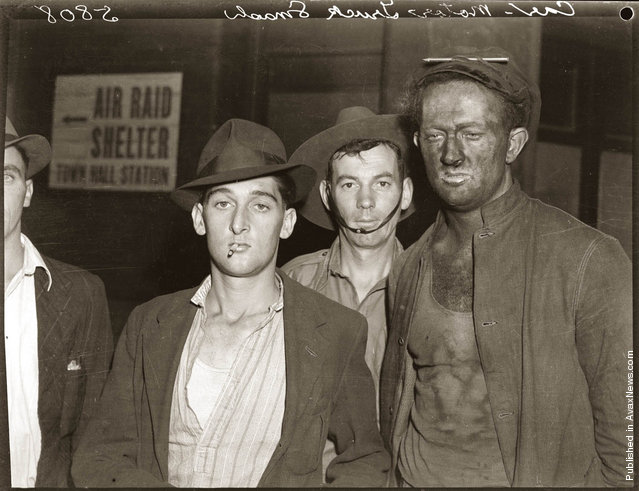 Four men, one partly obscured, photographed in connection with motor accident in the vicinity of Market Street, Sydney, early 1940s. Other details unknown.