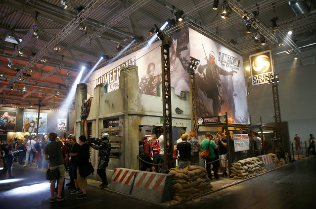 """Visitors queue to play """"Homefront: The Revolution"""", developed by video game producer Deep Silver during the Gamescom 2015 fair in Cologne, Germany August 5, 2015. (Photo by Kai Pfaffenbach/Reuters)"""