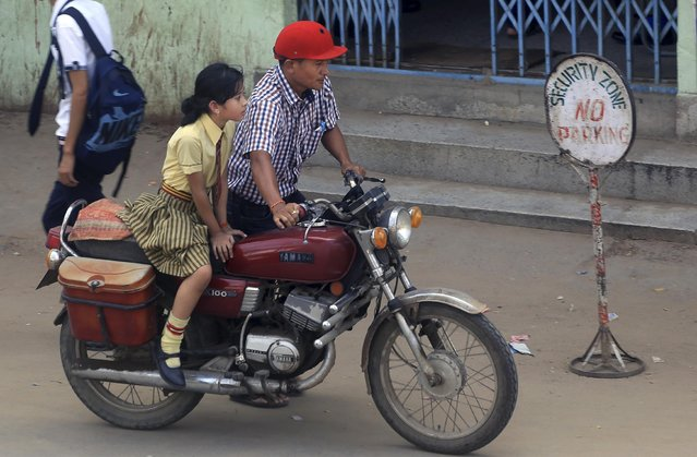A Naga girl sits on a bike as she leaves after attending school in Dimapur, in India's north-eastern state of Nagaland, Tuesday, August 4, 2015. India's government signed a peace treaty on Monday with Thuingaleng Muivah, leader of the Isak-Muivah faction of the National Socialist Council of Nagaland, in the presence of Prime Minister Narendra Modi aimed at ending a rebellion that has festered in India's Nagaland and Manipur states for more than six decades. (Photo by Sorei Mahong/AP Photo)