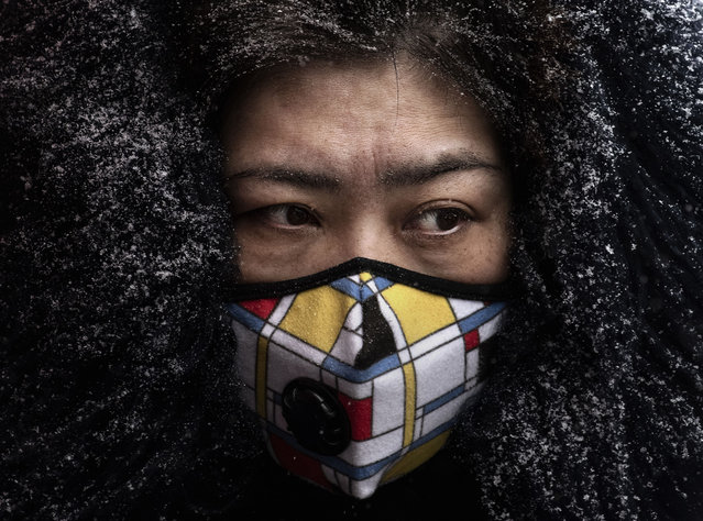 A Chinese woman wears a protective mask as she shops in a market on February 6, 2020 in Beijing, China. The number of cases of a deadly new coronavirus rose to more than 28000 in mainland China Thursday, days after the World Health Organization (WHO) declared the outbreak a global public health emergency. China continued to lock down the city of Wuhan in an effort to contain the spread of the pneumonia-like disease which medicals experts have confirmed can be passed from human to human. In an unprecedented move, Chinese authorities have put travel restrictions on the city which is the epicenter of the virus and municipalities in other parts of the country affecting tens of millions of people. The number of those who have died from the virus in China climbed to over 564 on Thursday, mostly in Hubei province, and cases have been reported in other countries including the United States, Canada, Australia, Japan, South Korea, India, the United Kingdom, Germany, France and several others. The World Health Organization has warned all governments to be on alert and screening has been stepped up at airports around the world. Some countries, including the United States, have put restrictions on Chinese travelers entering and advised their citizens against travel to China. (Photo by Kevin Frayer/Getty Images)