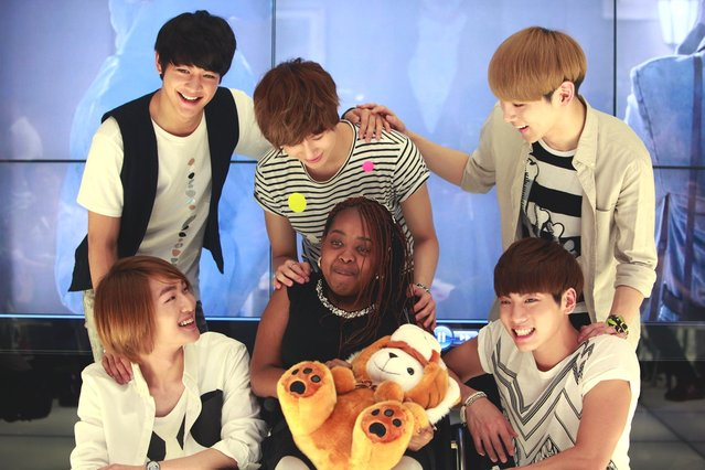 15-year old Terminally Ill American girl Donica Streling meets with members of SHINee (샤이니) at SM Entertainment head office on June 20, 2012 in Seoul, South Korea