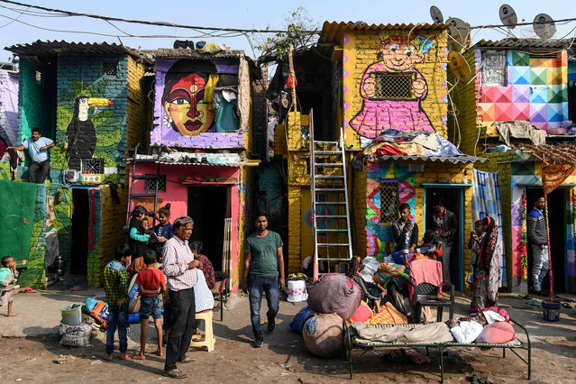 """Murals have been painted by 15 to 20 artists from """"Delhi Art Street"""" group to reflect nature and the life of inhabitants on the walls of houses at a slum in New Delhi on December 1, 2019. (Photo by Sajjad Hussain/AFP Photo)"""