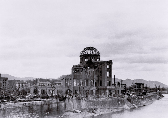 The gutted Hiroshima Prefectural Industrial Promotion Hall (C), currently known as Atomic Bomb Dome or A-Bomb Dome, is seen near Aioi Bridge in Hiroshima after the atomic bombing of Hiroshima, Japan, on August 6, 1945, in this undated handout photo taken by Toshio Kawahara and released by his grandchild Yoshio Kawamoto. (Photo by Toshio Kawamoto/Yoshio Kawamoto/Reuters)