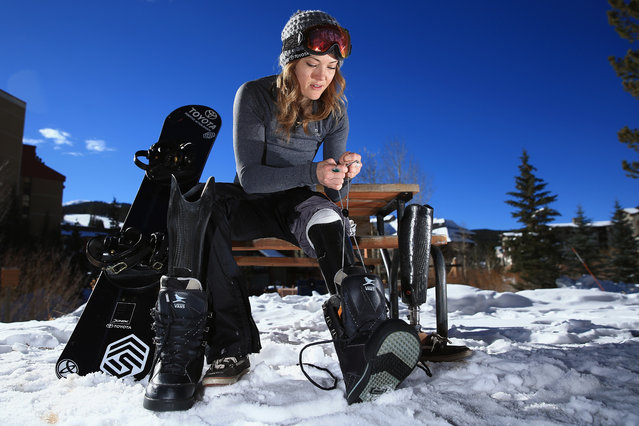 Amy Purdy swaps her prosthetic legs as she prepares for a training session on December 16, 2013 in Copper Mountain, Colorado. Purdy is a a member of the US Paralymic Snowboard Team and co-founder of Adaptive Action Sports. (Photo by Doug Pensinger/Getty Images)