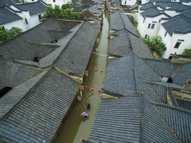 An aerial photo shows a flooded street in Tongcheng City of Anqing, east China's Anhui Province on July 4, 2016. China's meteorological authority renewed its orange alert for heavy rain in the south and southwest of the country on Monday, warning heavy rain would hit the provinces of Anhui, Jiangsu, Hubei, Jiangxi, Hunan and Guizhou, and Guangxi Zhuang Autonomous Region until Tuesday morning, with precipitation reaching 200 millimeters in some areas. (Photo by Li Bo/Xinhua via ZUMA Wire)